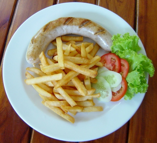 German bratwurst with french fries and salad