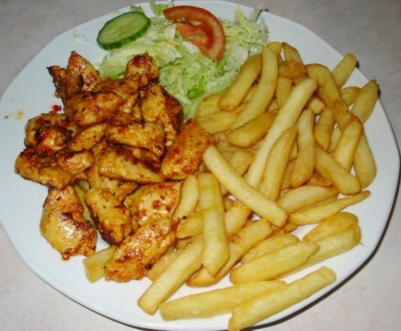 Chicken kebab with french fries and salad