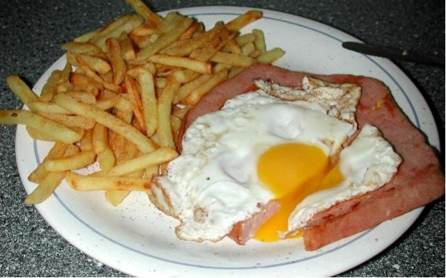 German (Leberkase) meatloaf with french fries and salad and fried egg