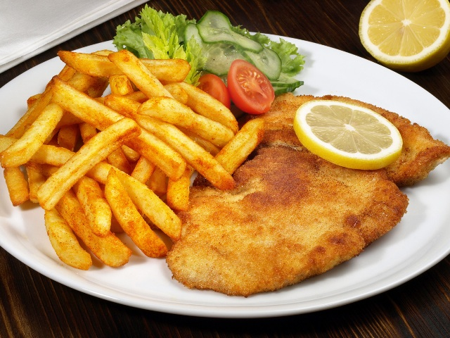 Pork schnitzel with french fries and salad